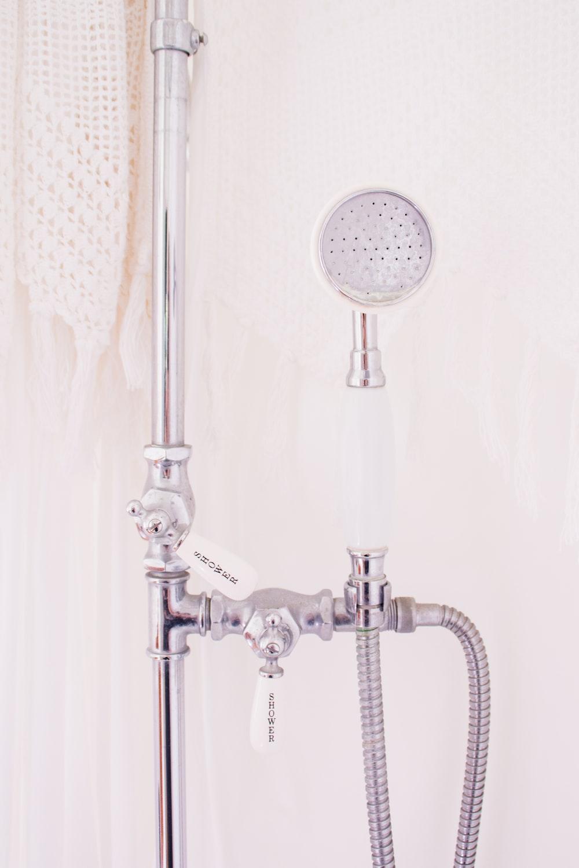 gray metal handheld shower head