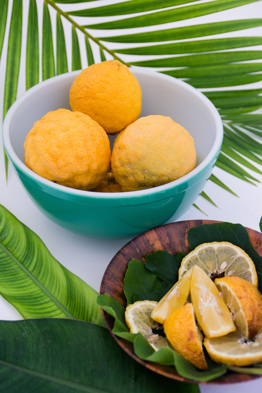 sliced lemon on teal and white ceramic bowl