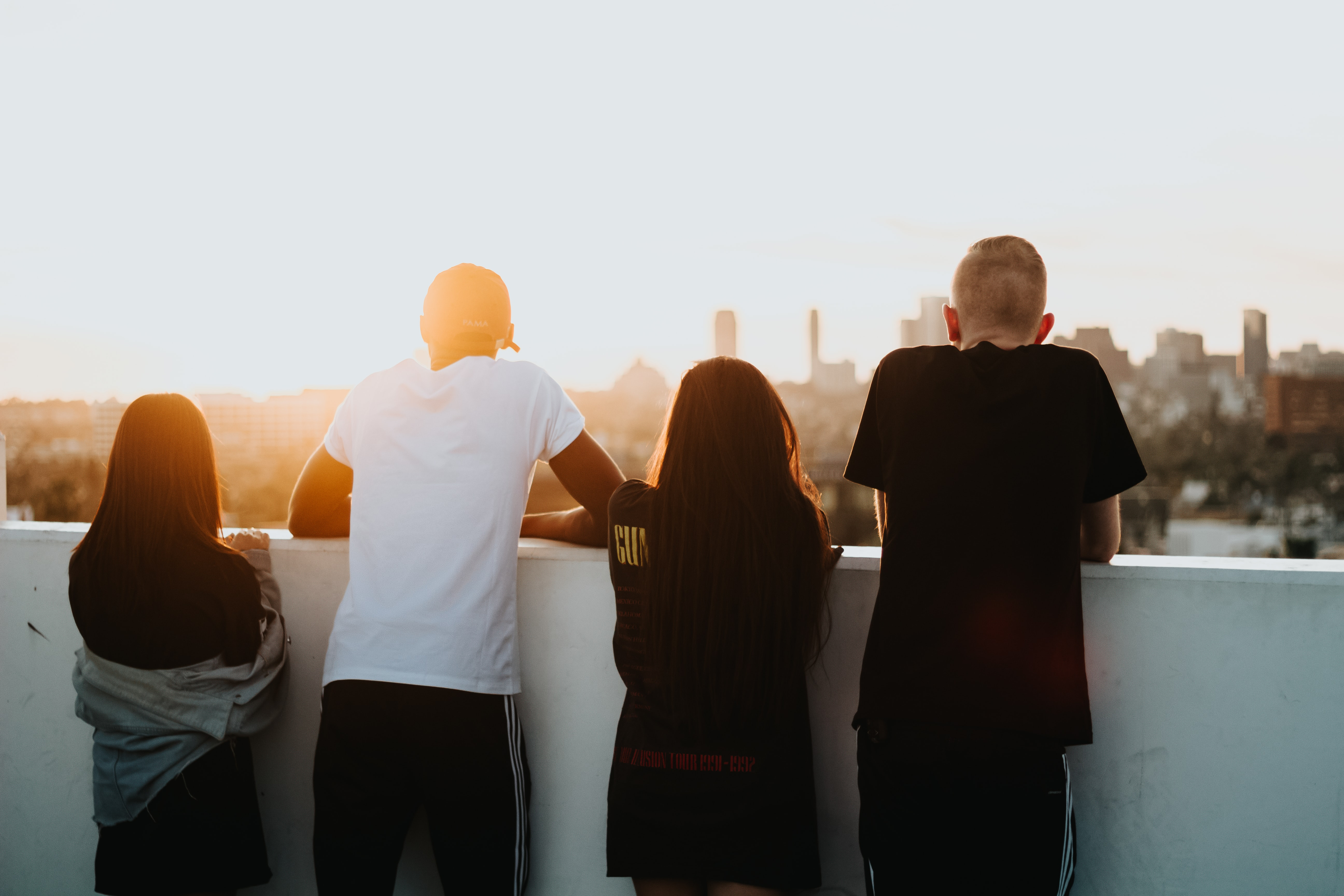 four person looking at the city