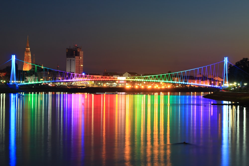 lighted bridge with calm water