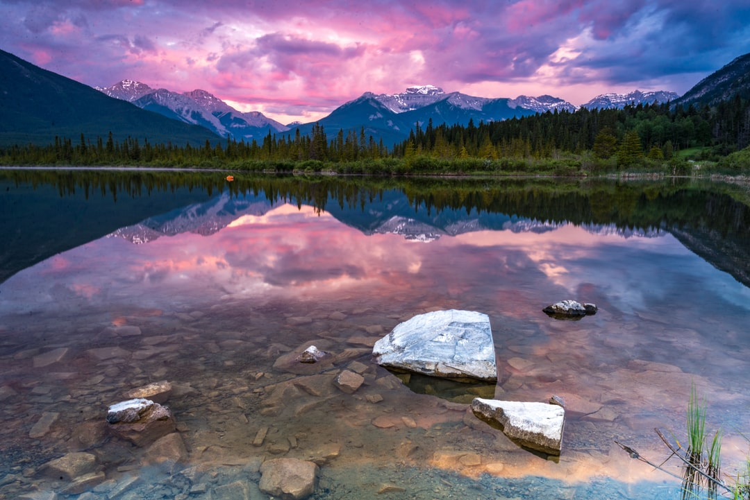 While visiting Banff, Canada, I headed over to Vermillion Lakes to catch the sunset.  The clouds were thick as a storm was approaching so the best view was this gorgeous purple cast in the clouds and reflected in the water.
