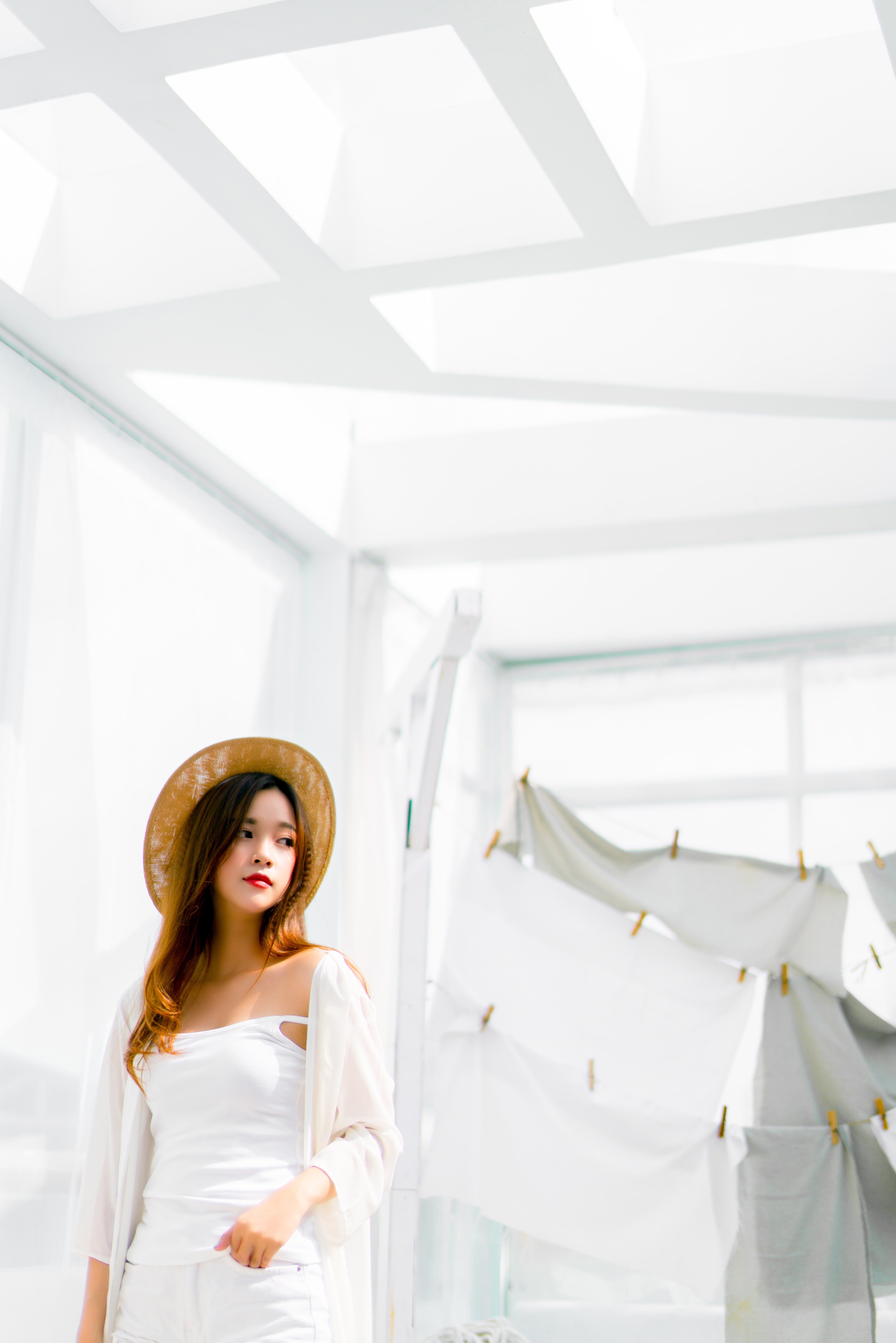 woman standing near hanging clothes