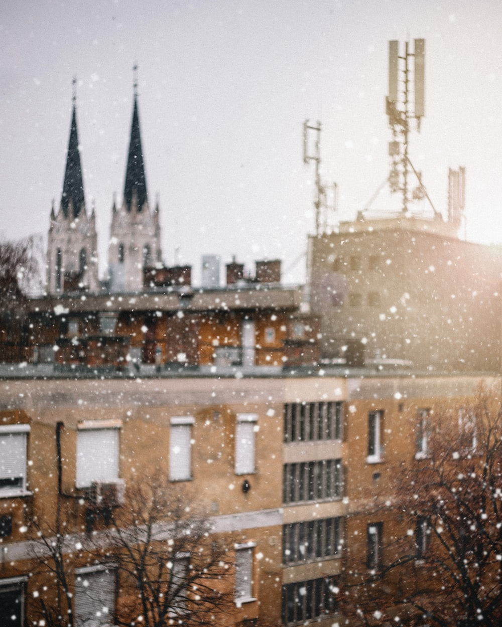 photo of a snow weather and brown concrete building