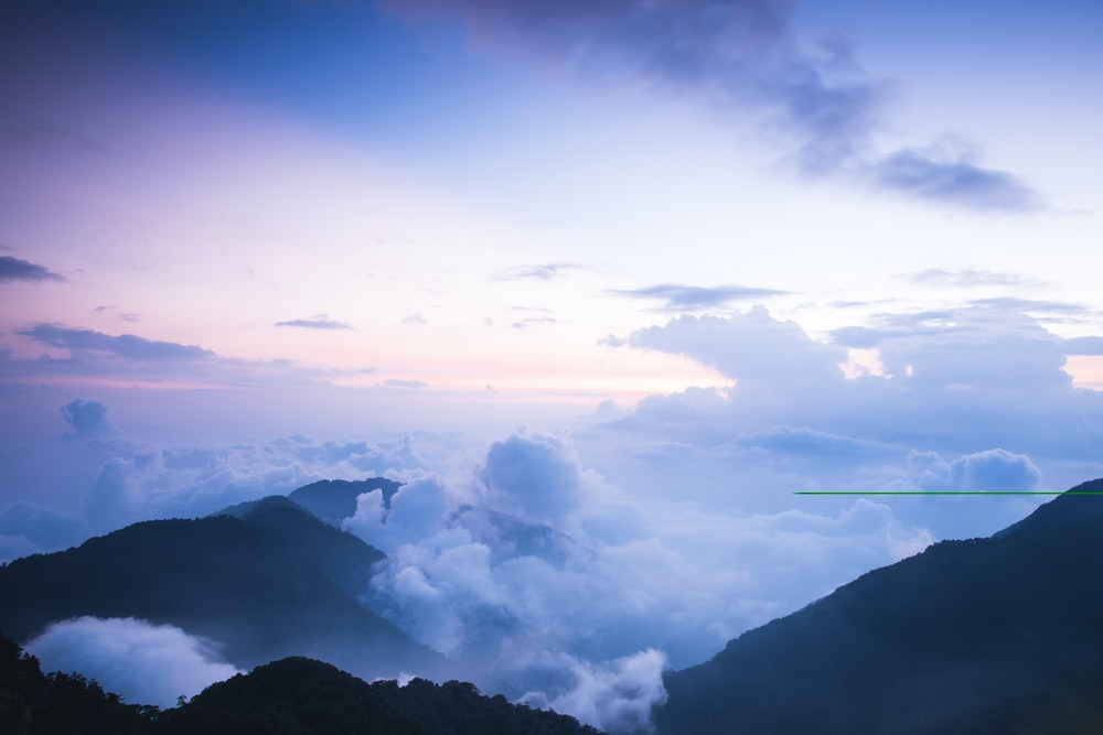 photo of a cloudy mountain