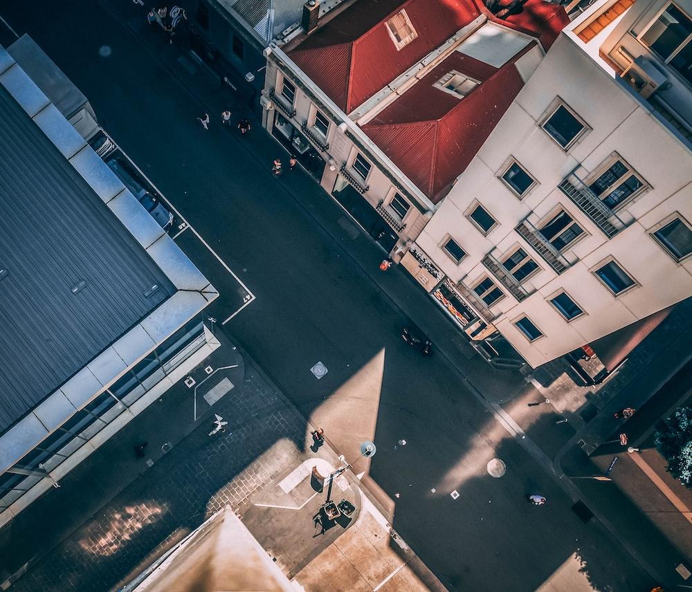 aerial photography of asphalt road between buildings