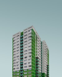 green and white concrete high-rise building at daytime