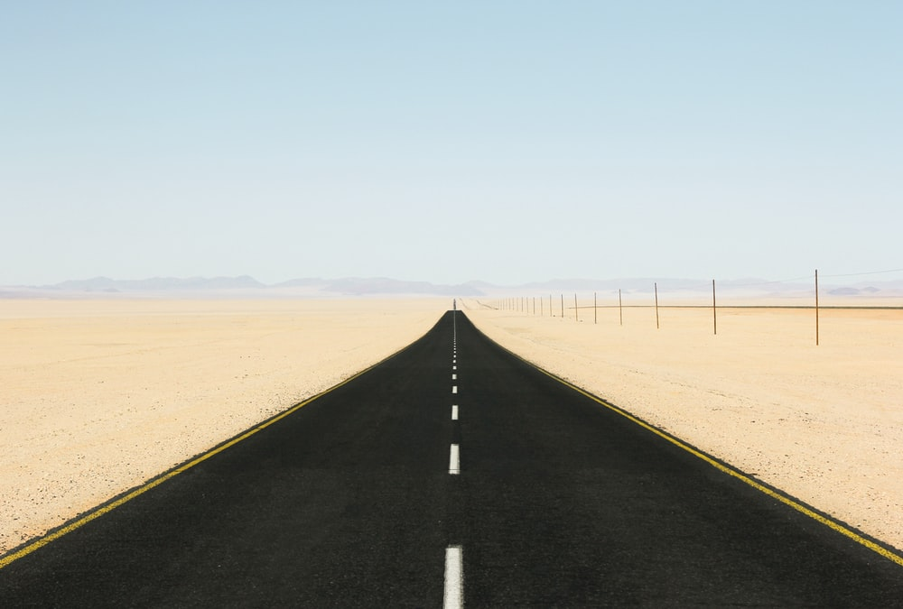 black asphalt road taken at daytime