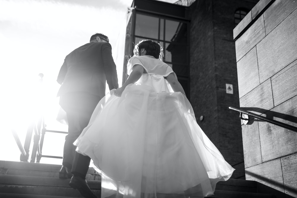 bride and groom walking on staircase