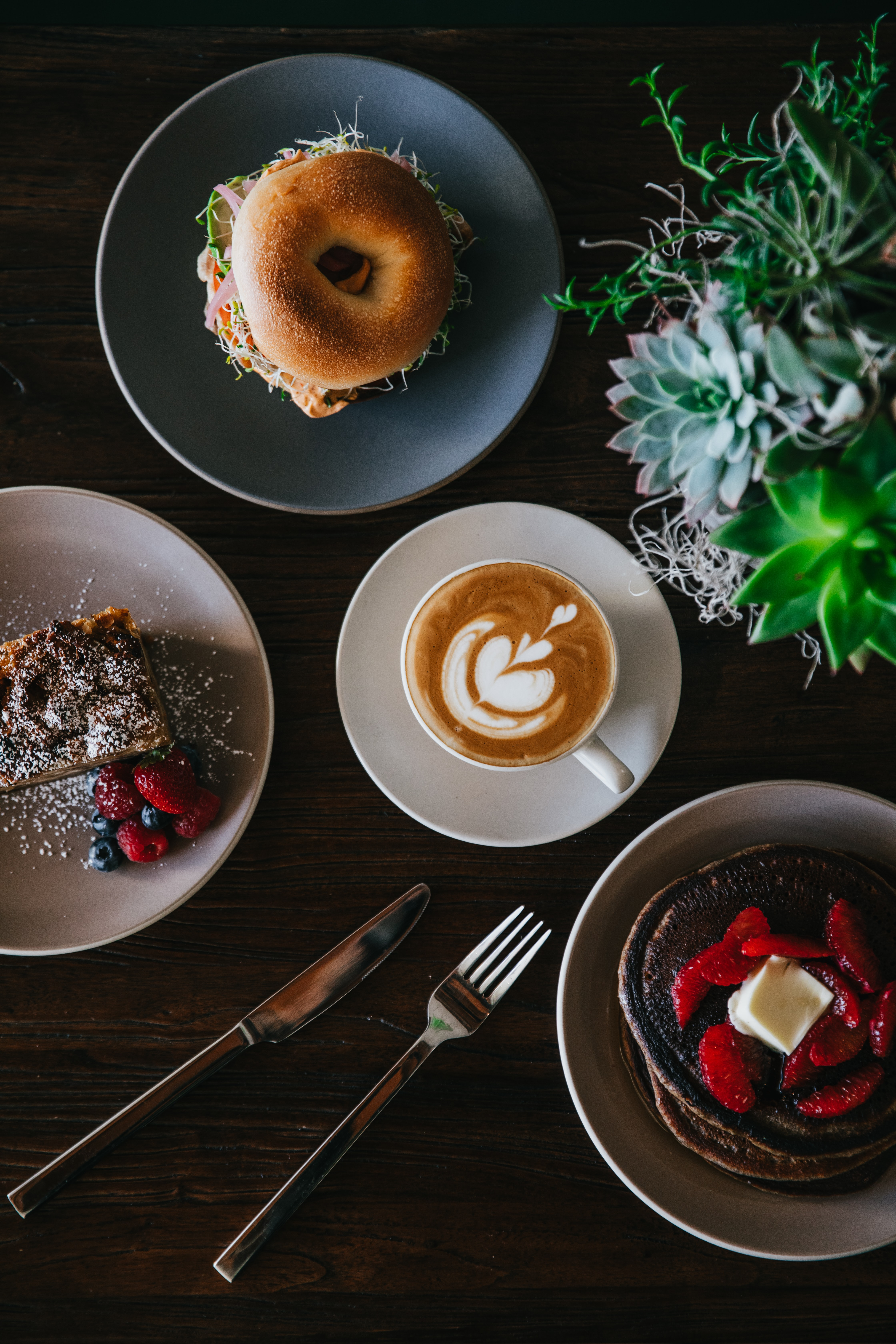 coffee with latte art surrounded with sweets