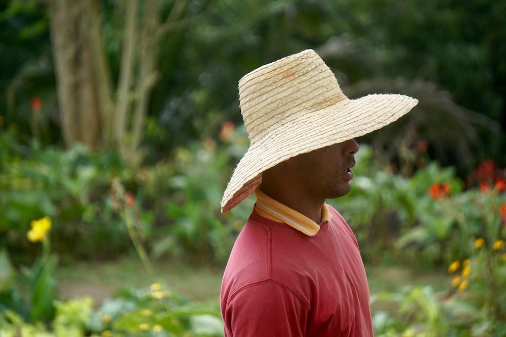 man standing near garden