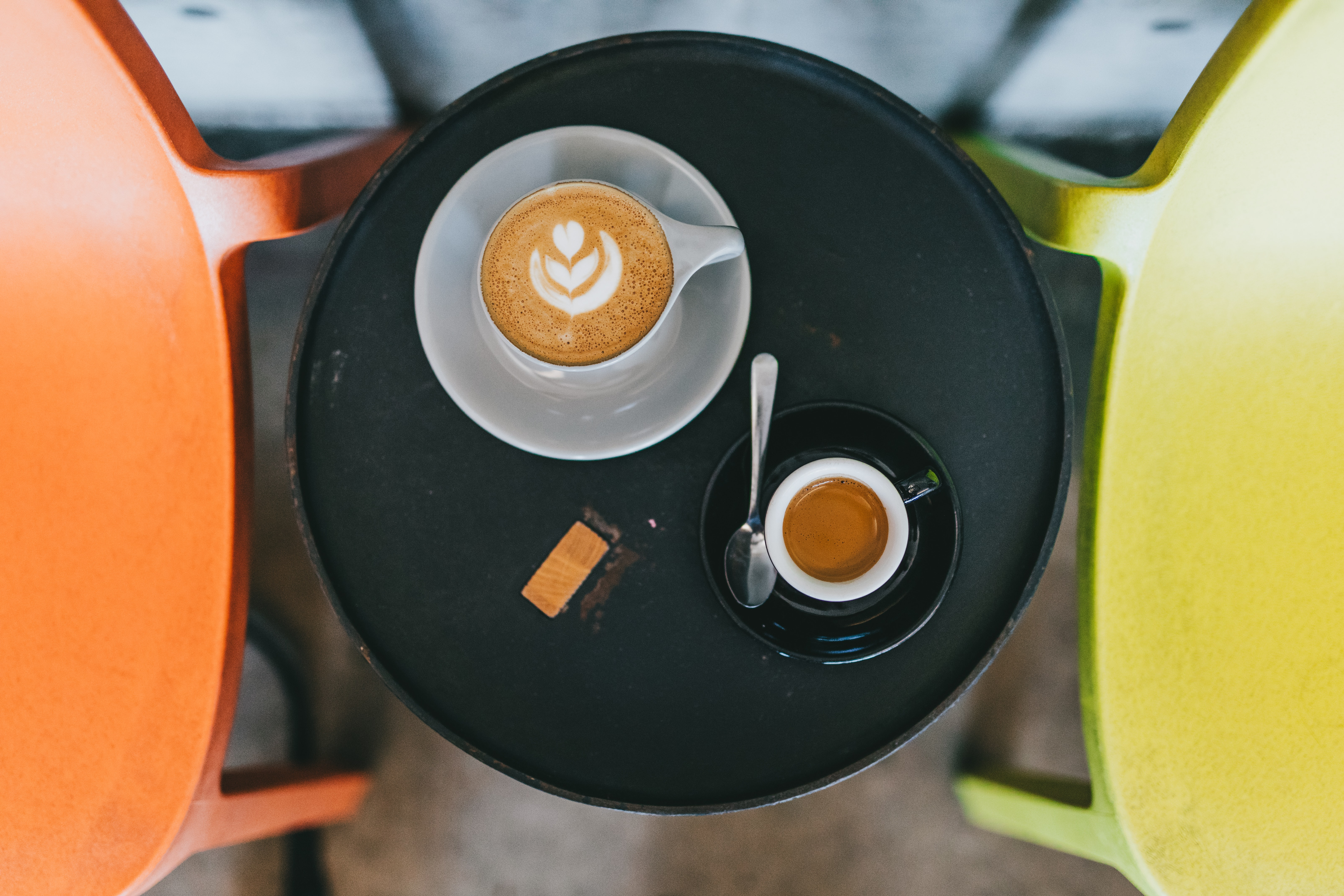 aerial photo of two cups of coffees on saucer