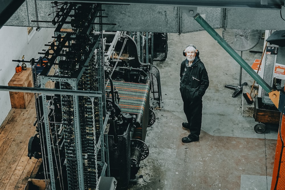 man standing on front of industrial machine