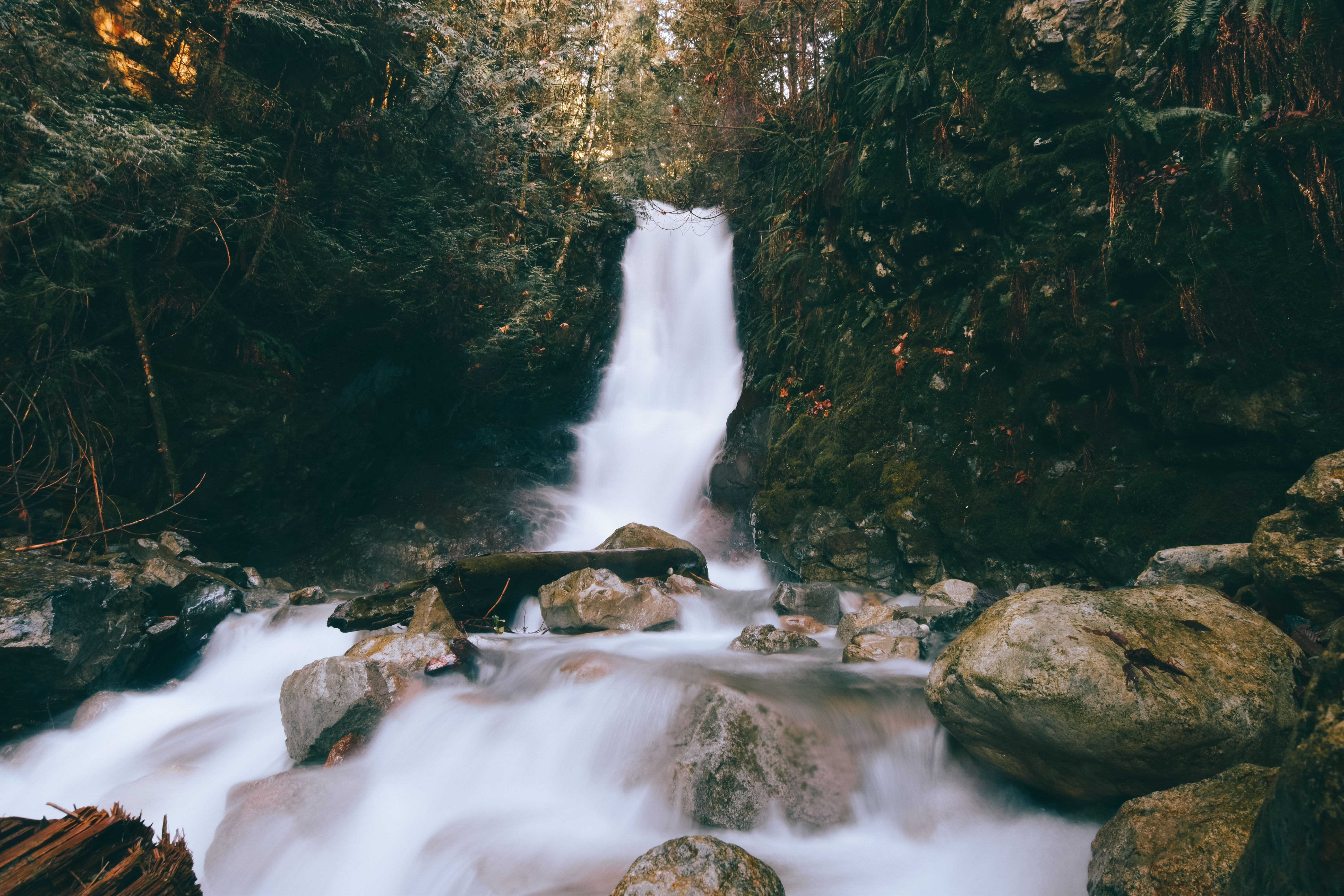 time-lapse photography of waterfalls and stones during daytime