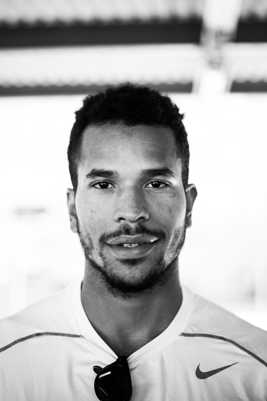 grayscale photo of man wearing Nike shirt
