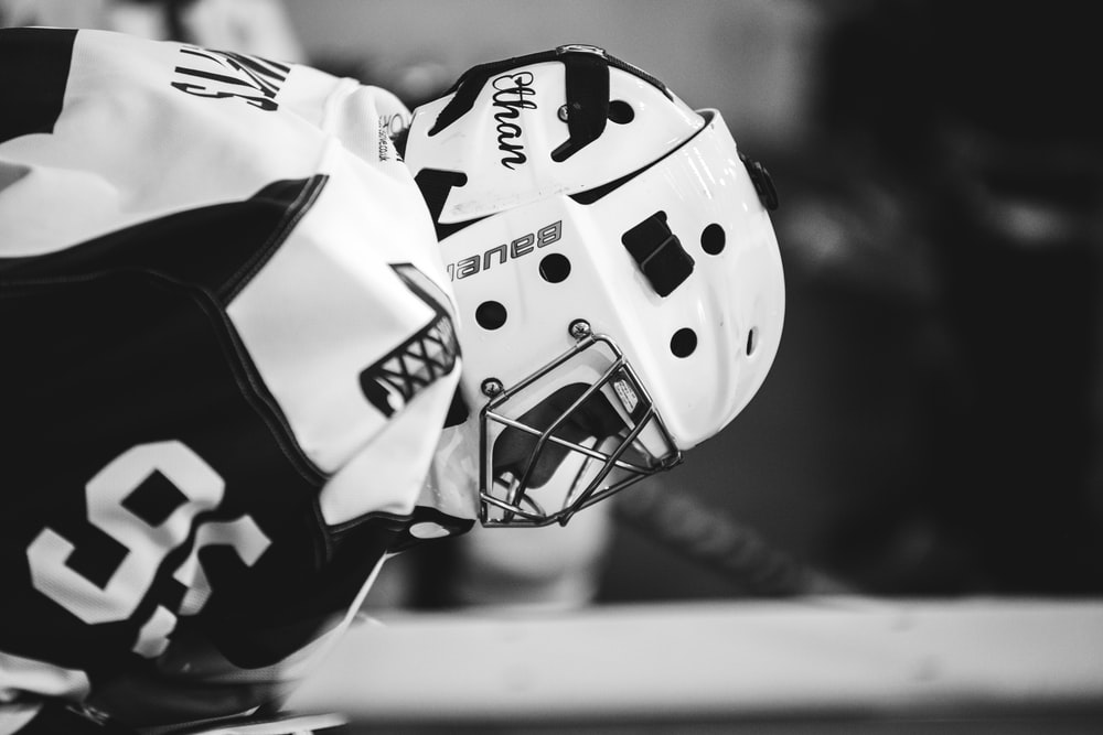 grayscale photo of ice hockey player