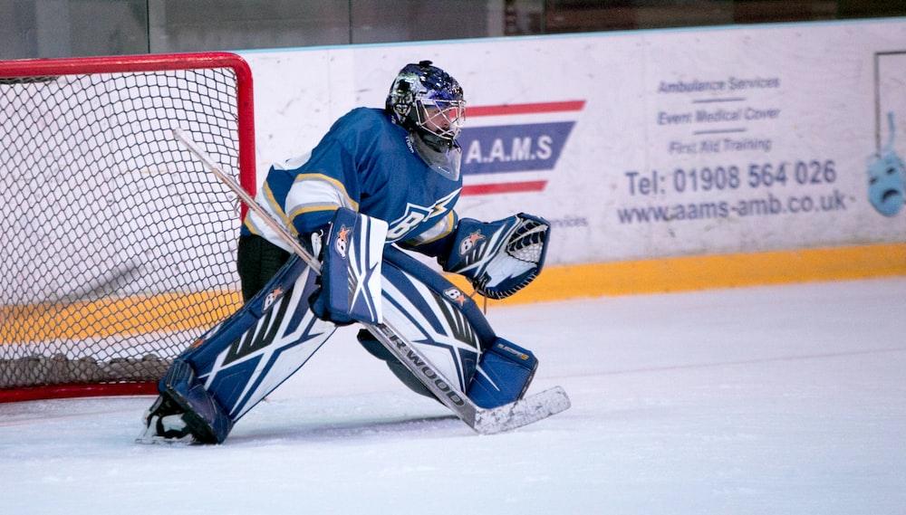 ice hockey goalie defending the goal