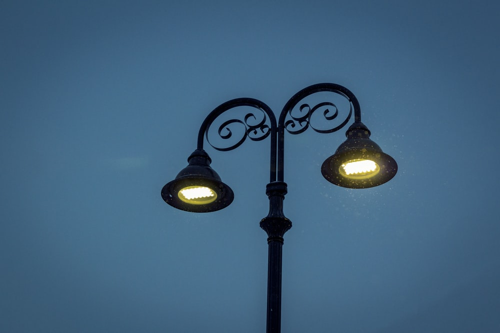black 2-light street lamp turned on during night
