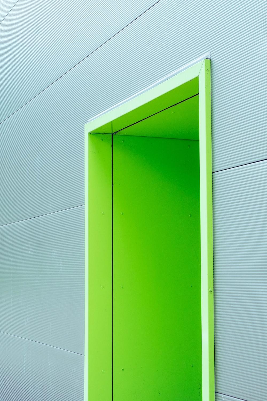 green door with gray wall