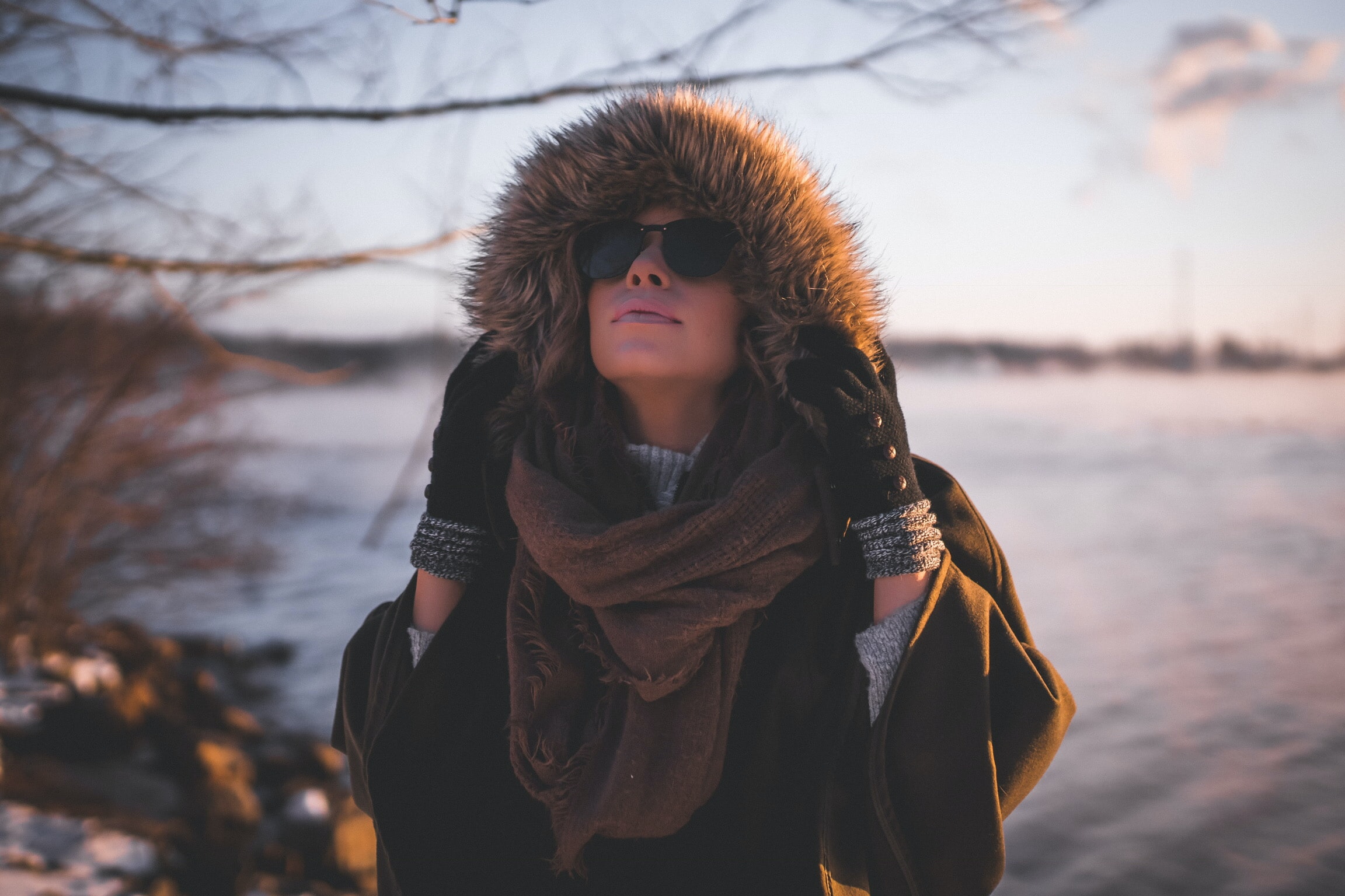 woman wearing fur hoodie near water