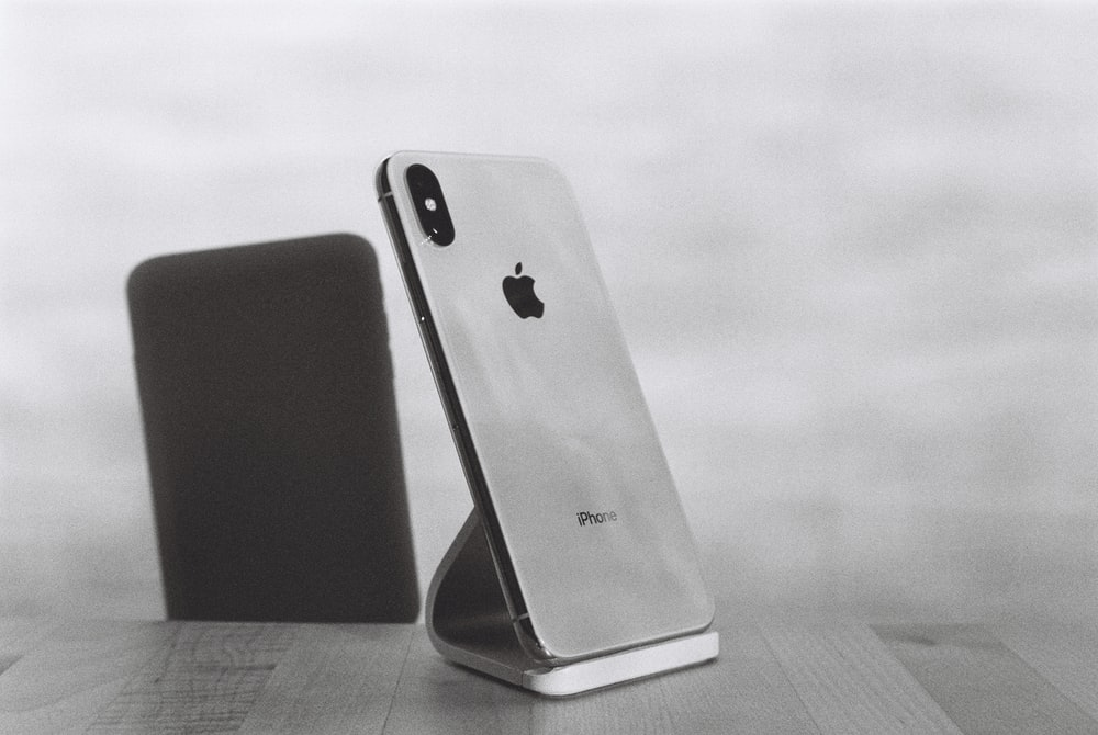 silver iPhone X on stand
