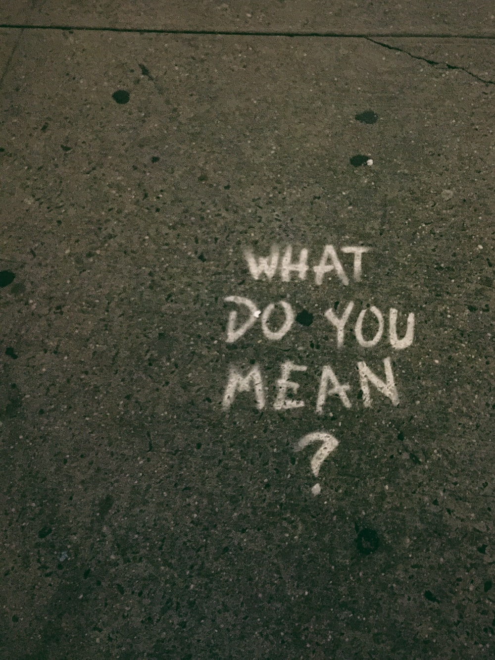what do you mean? text on gray surface
