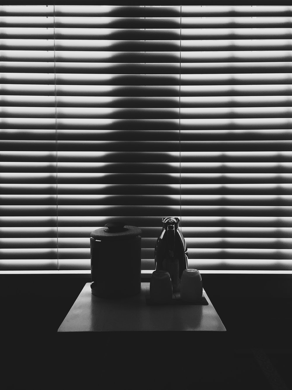 black container and pitcher on top of table