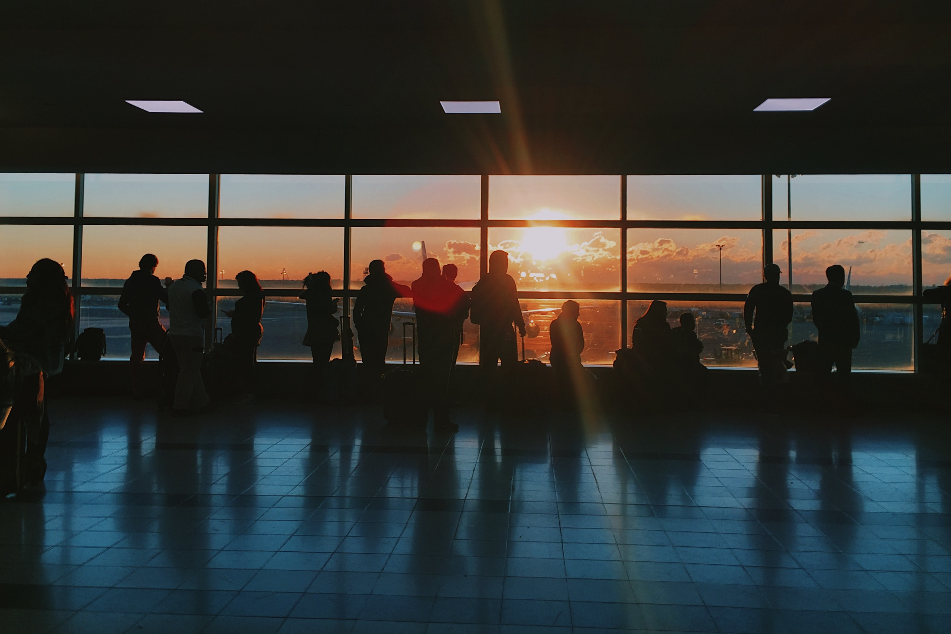 silhouette of people inside airport