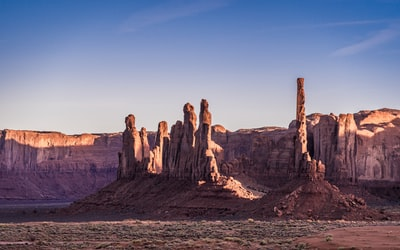 As golden hour created light and dark shades of these totem poles, I kept wondering if these poles were actually beings standing and gazing at the desert.