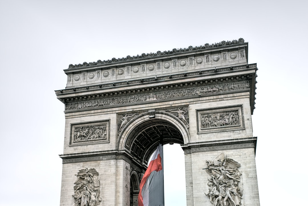 This is an old photograph that I took in 2016, at the time when Paris was flooded, the Siene was overflowing, and the sky was gray and boring. In this picture, however, I think the colours of the French flag contrasts nicely with the gray sky and somewhat plain Arc de Triomphe.