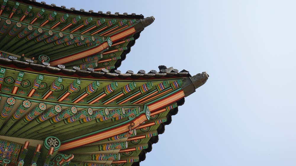 green and black pagoda roof