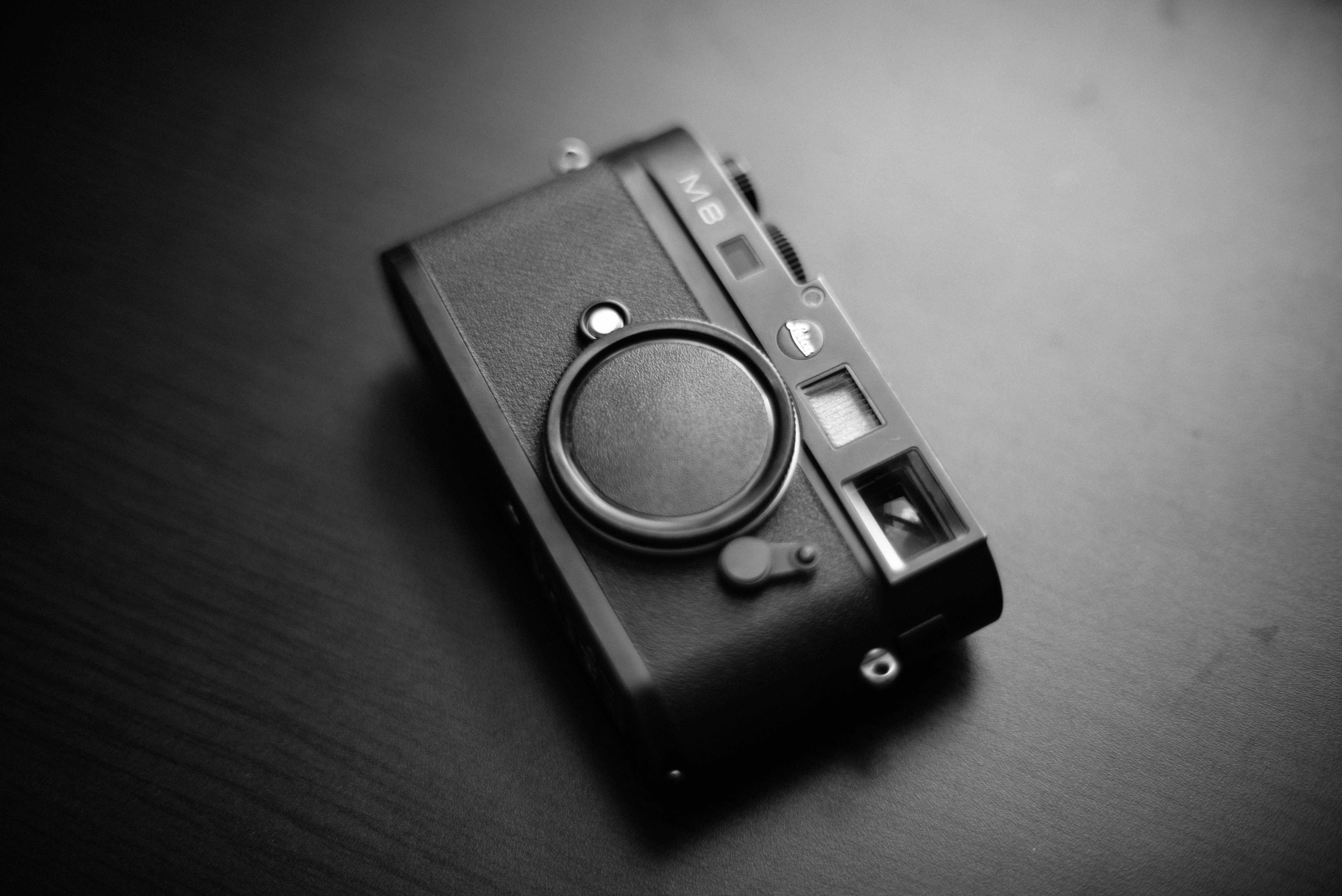 grayscale photo of M8 camera on table