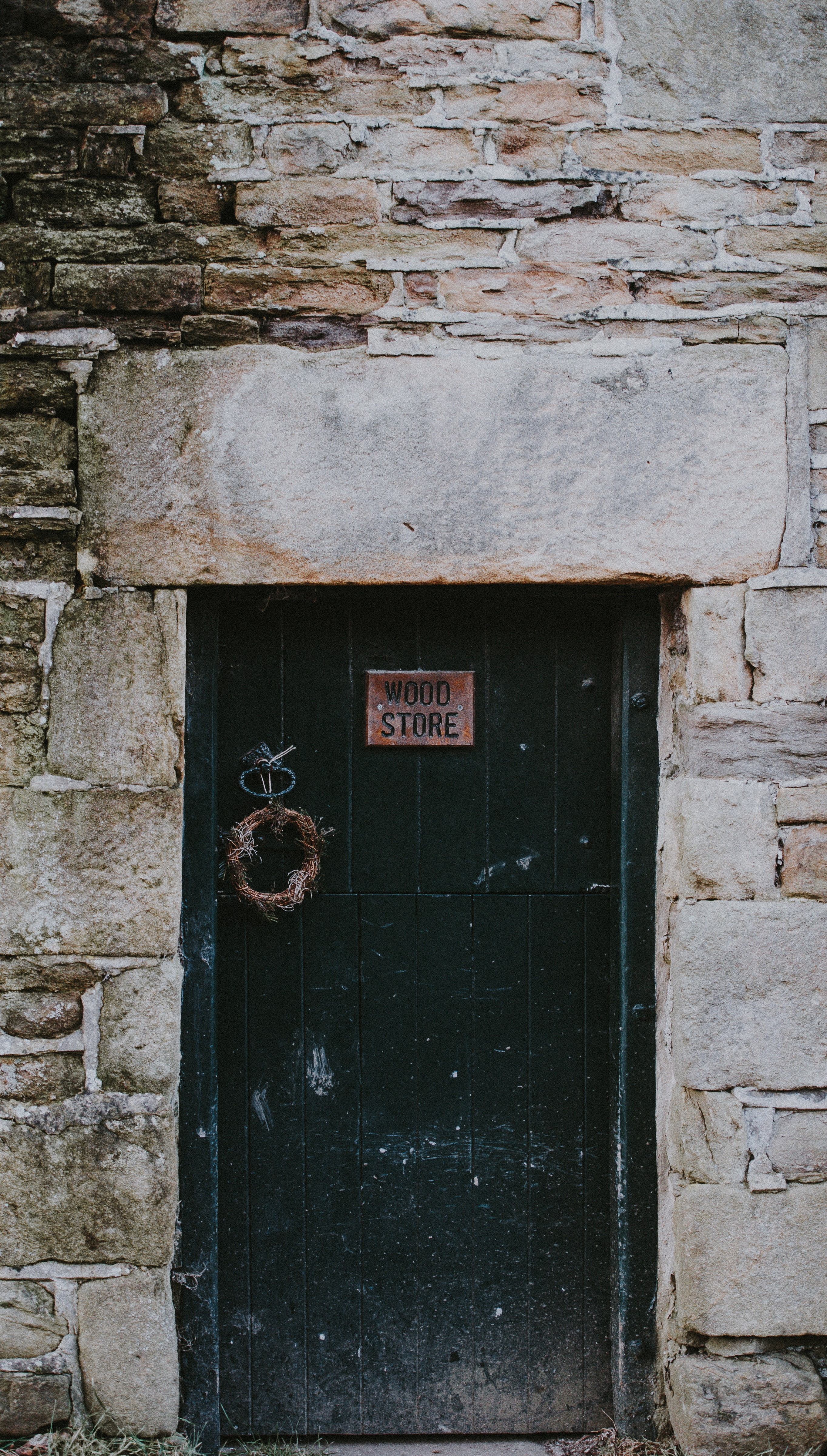 black wooden door close with wood store signage