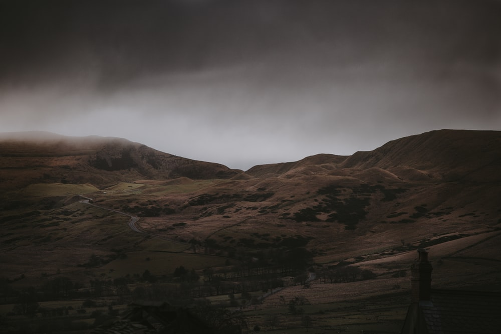 landscape photography of gray mountains under cloudy skies