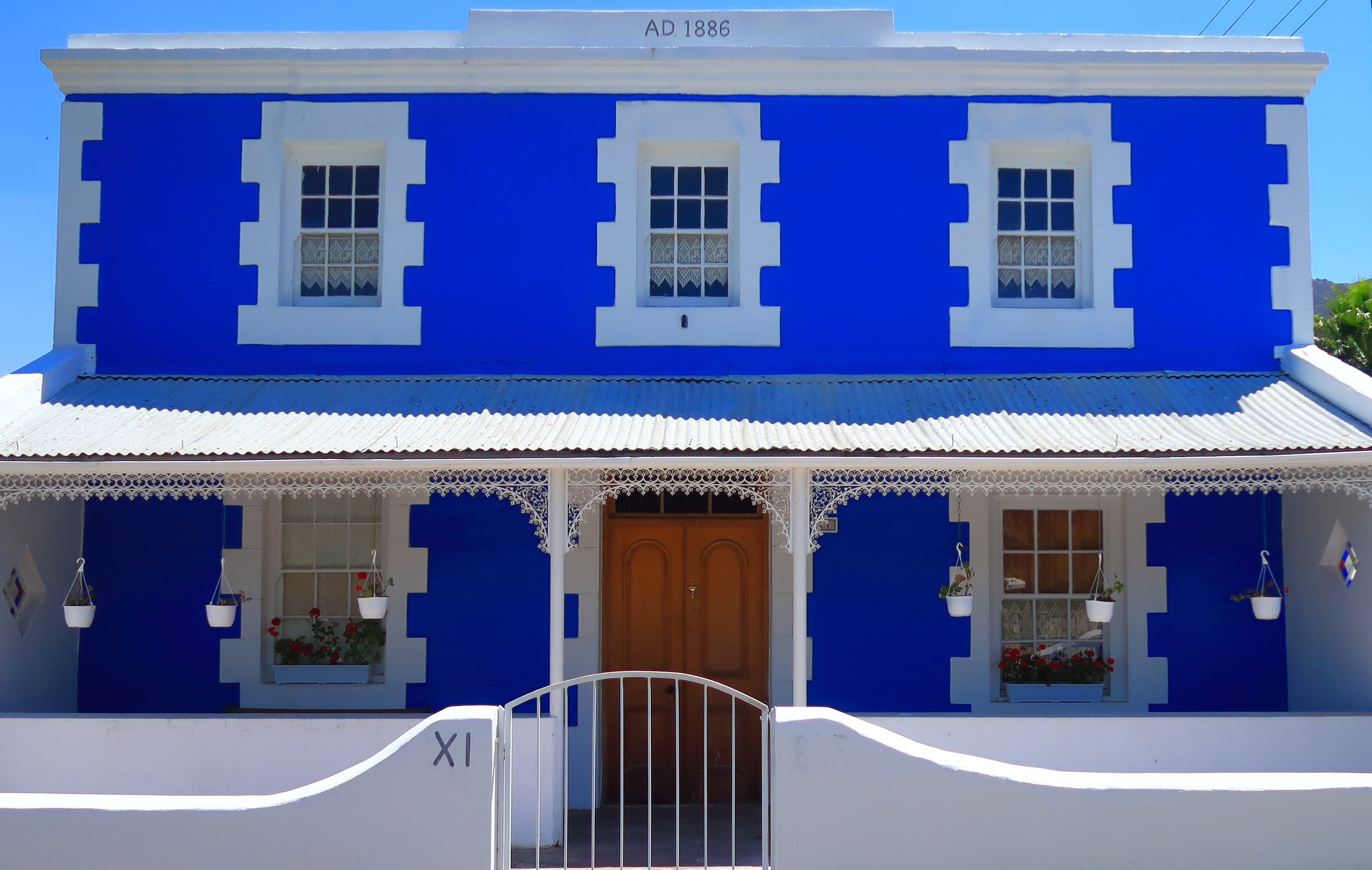white and blue painted 2-storey house