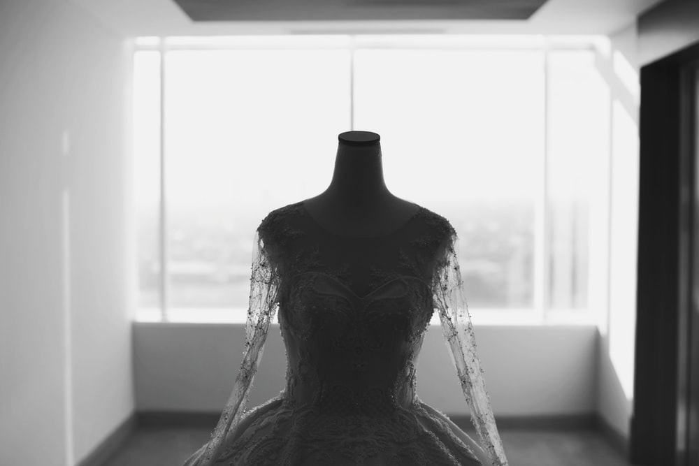 grayscale photo of wedding dress