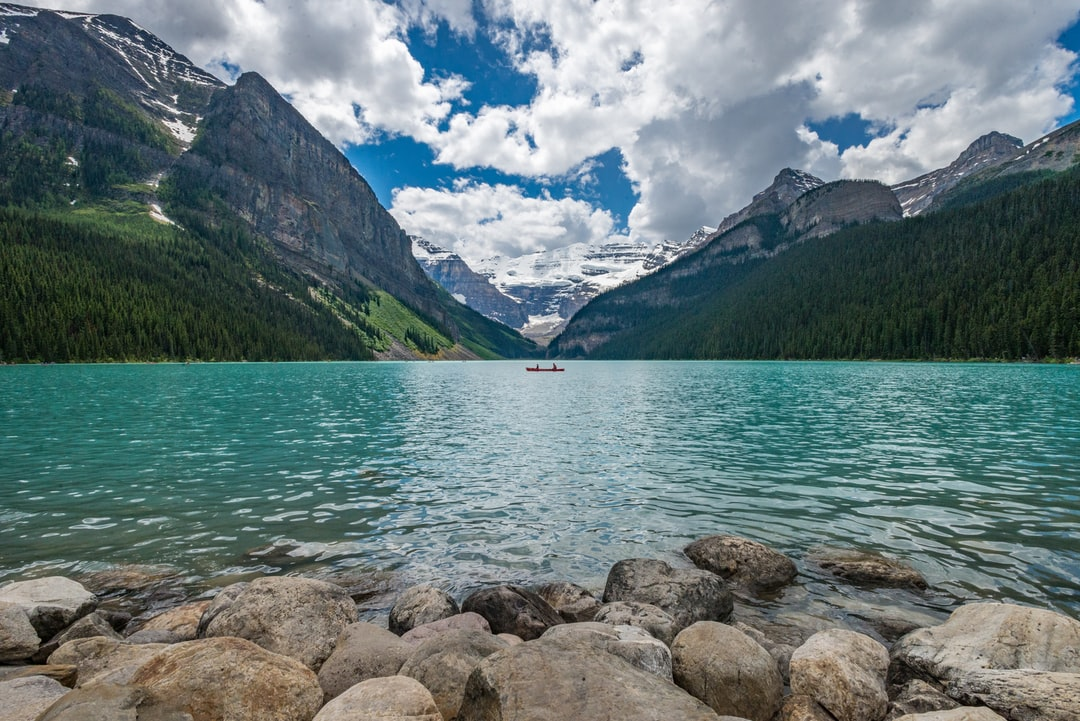 Had the chance to visit Banff National Park together with my daughter.  We drove up the length of the park with a stop at Lake Louise.  Our first views of this amazing landscape caught this canoe at the intersection of the two mountains.