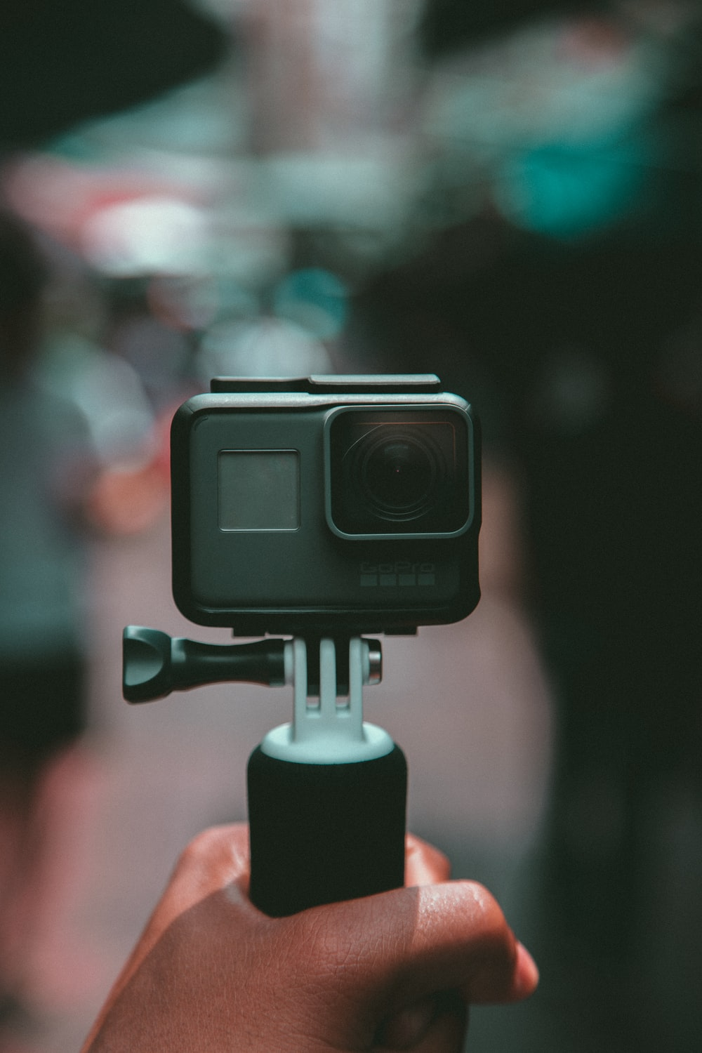 selective focus photography of gray action camera