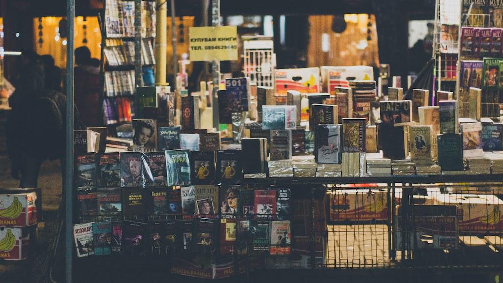 assorted books on rack