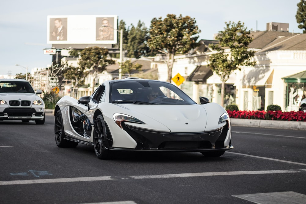 white coupe on road