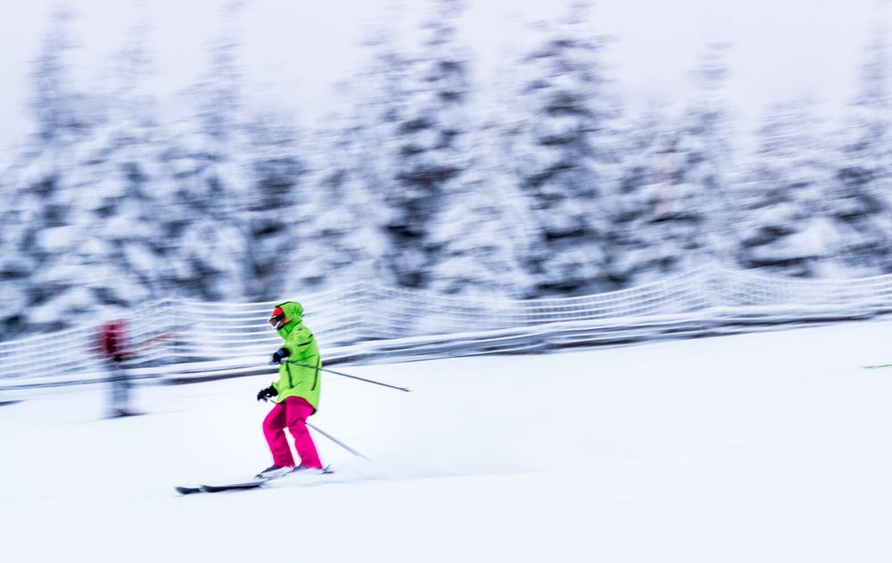 selective focus photography of person on ski blades at ski track
