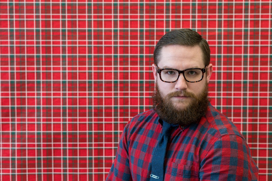 Walking to class one afternoon, I noticed that a fellow teacher had yet to remove their Christmas decorations. Including this plaid, wrapping paper background. The background matched so well with my ensemble that day I had to get a portrait! I asked one of my students to shoot this for me after getting my camera settings right.  This was the awkward result of that rushed, fateful photo shoot.
