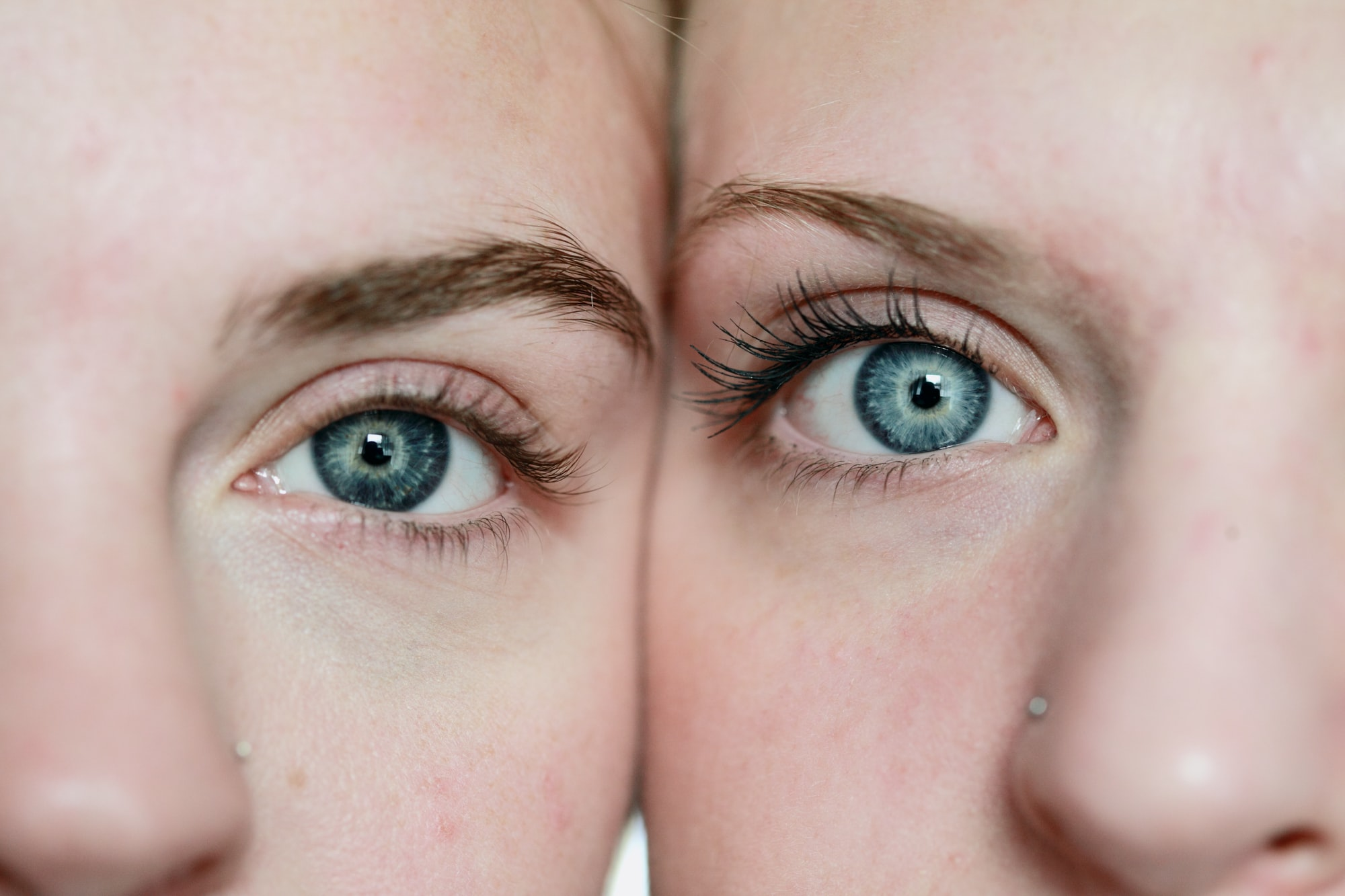 A close up macro shot of two girls with blue eyes. These girls are my two eldest daughters. I shot this using available natural light from a south facing window.