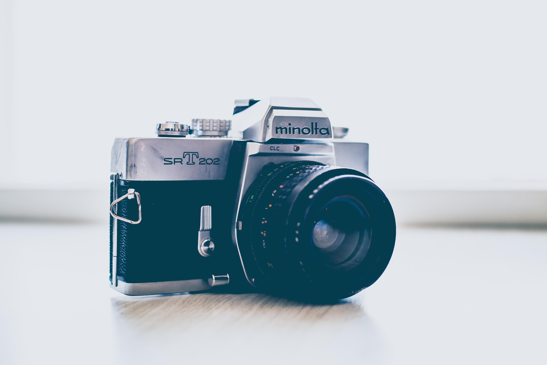 gray and black Minolta DSLR camera