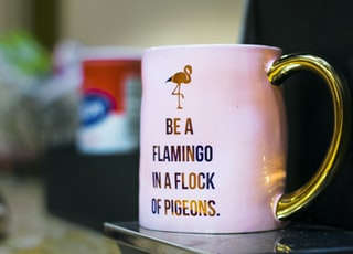pink and gold ceramic mug