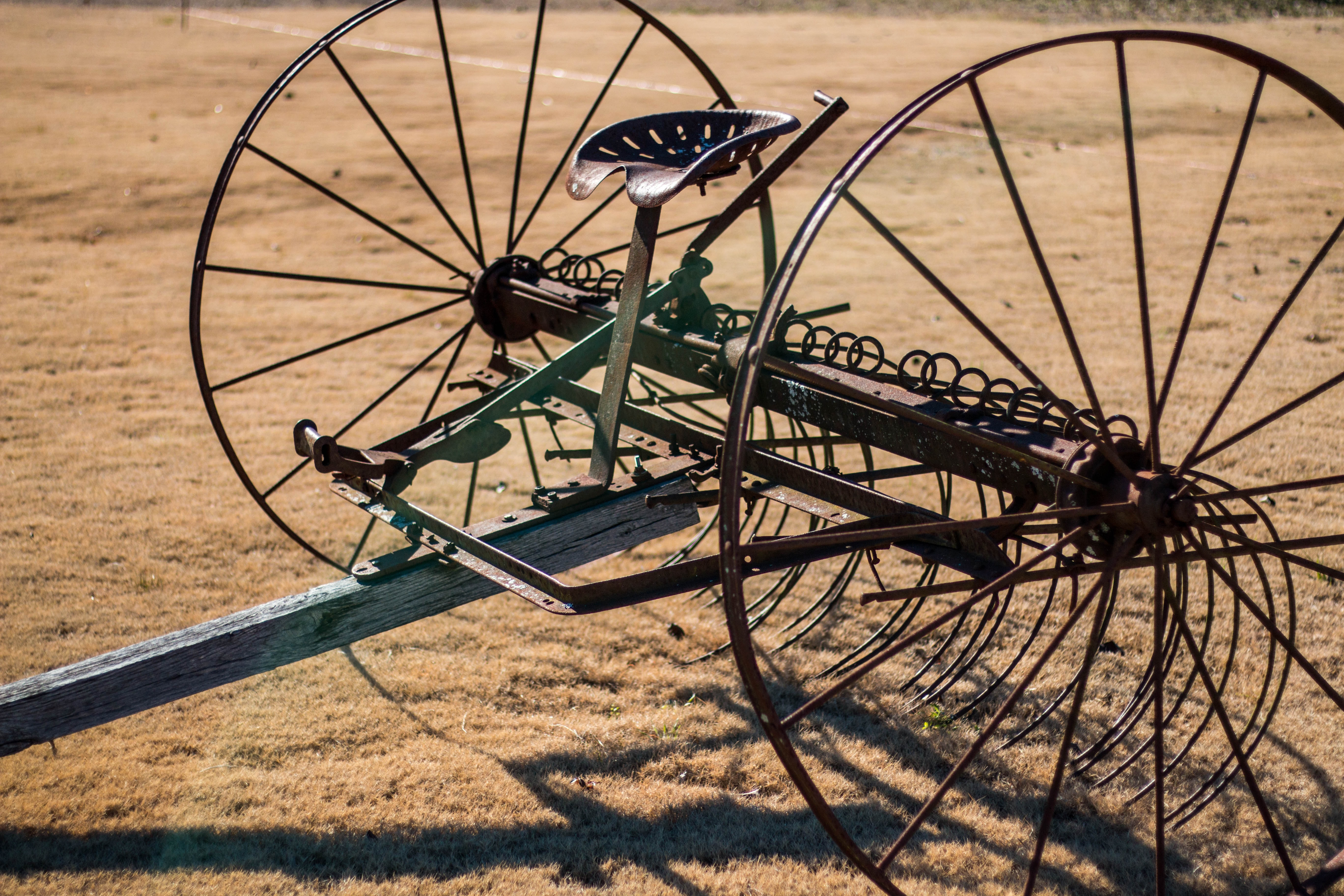 black and gray farm equipment on brown open field