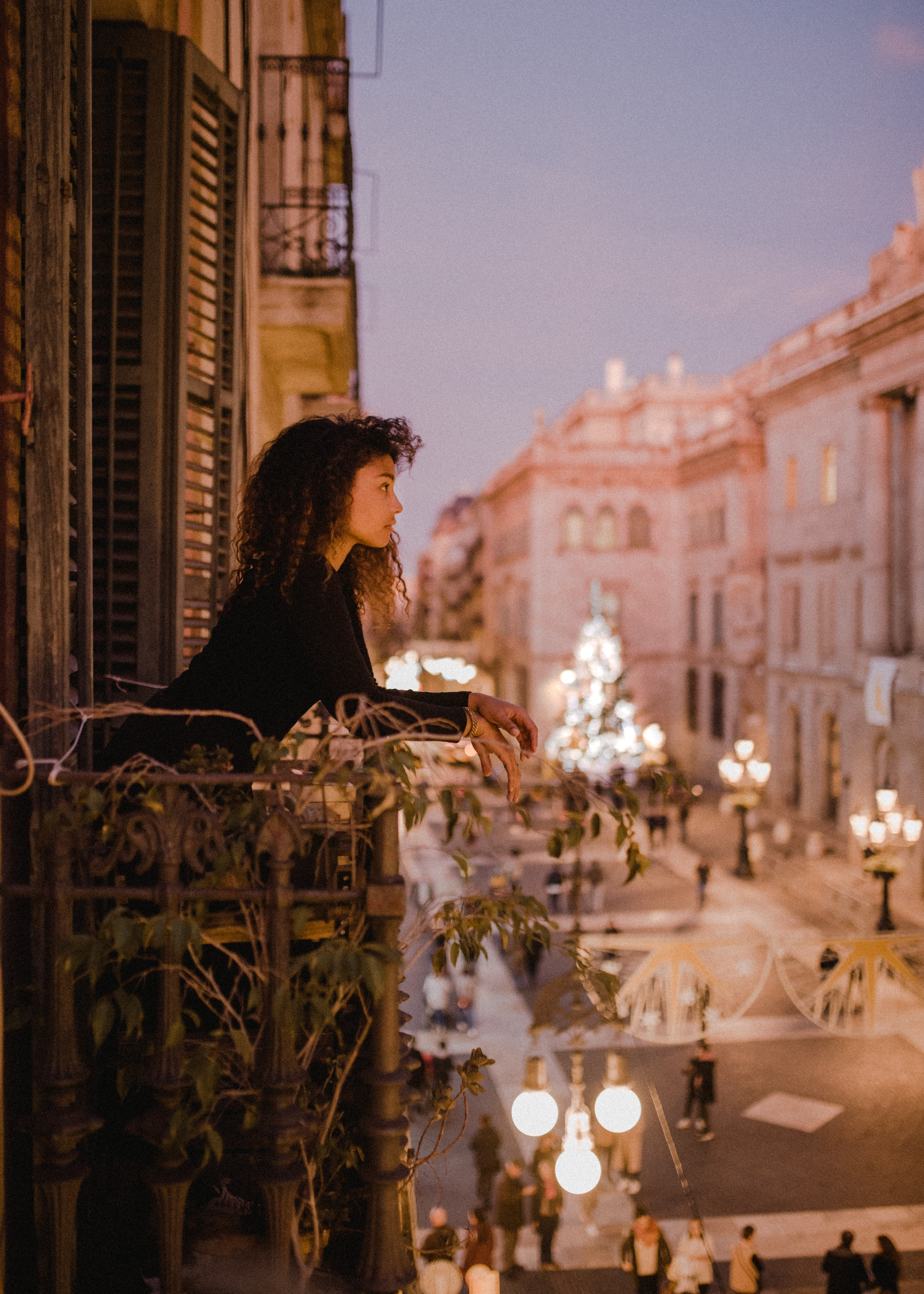 woman leaning on balcony fence