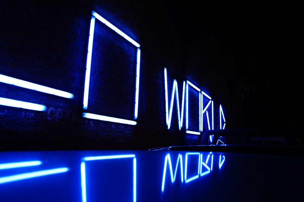 blue neon light signages