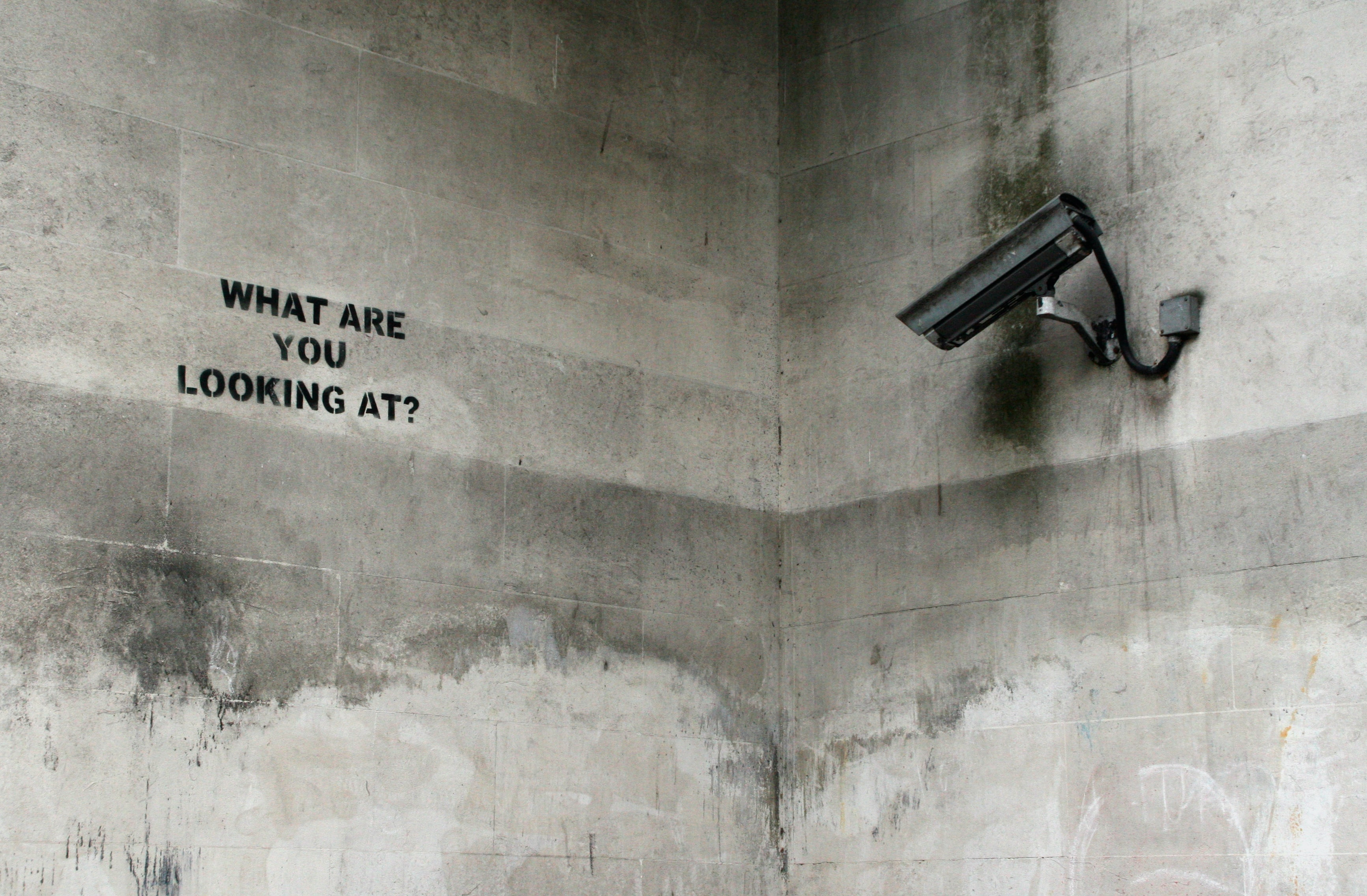 black CCTV camera on wall