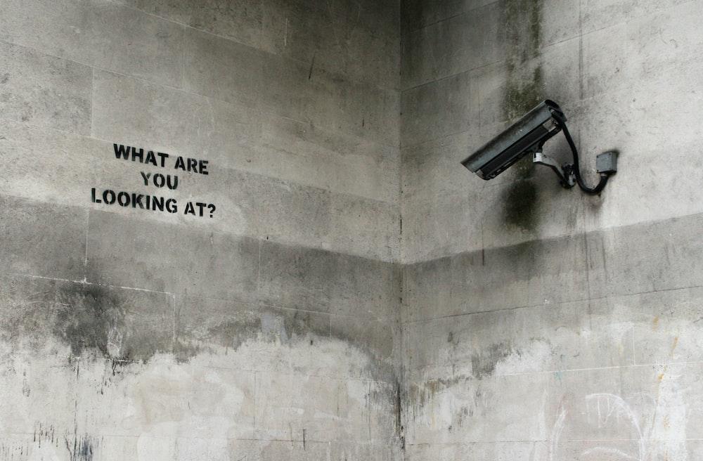 black CCTV camera on wall