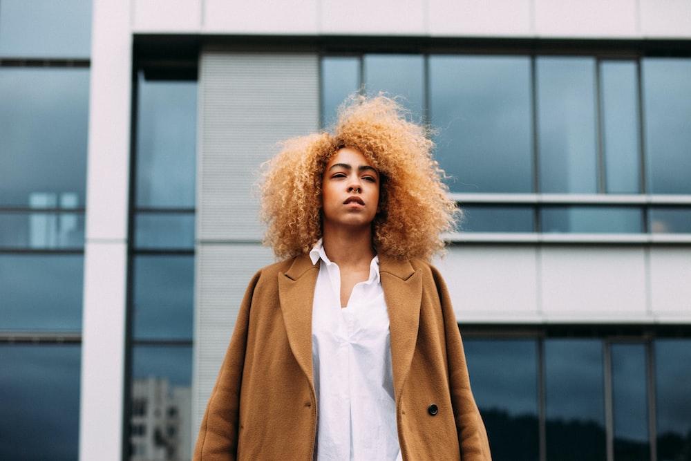 woman standing near concrete building